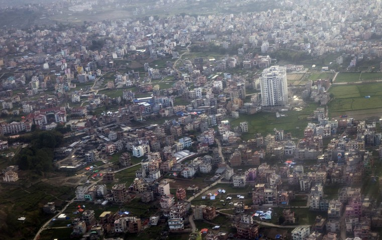 This aerial picture taken on April 27, 2015 shows earthquake-hit buildings in Kathmandu. The death toll from the devastating earthquake has risen to 4,310, the home ministry said. (China Out)