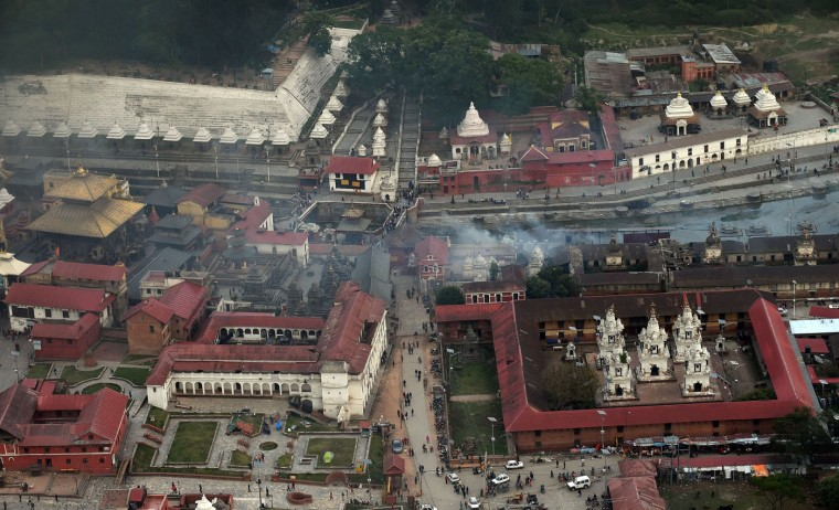 An aerial view of the mass cremations taking place at Pashupati Nath temple in Kathmandu on April 29, 2015, following a devastating earthquake on April 25.  Desperate Nepalis clashed with riot police and seized supplies of bottled water in the capital April 29 as anger boiled over among survivors of an earthquake that killed more than 5,000 people.  (Prakash Singh/AFP/Getty Images)
