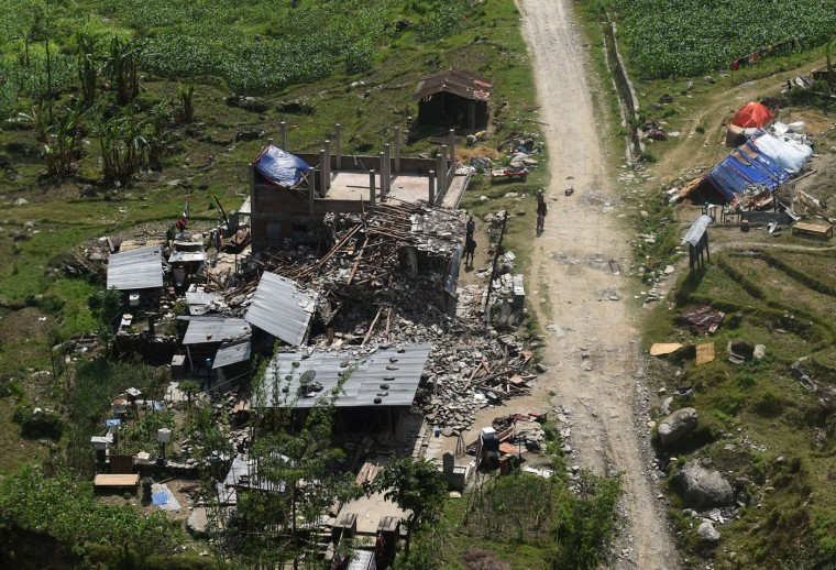 This aerial view taken from an Indian army helicopter shows damaged homes in Gorkha District on May 1, 2015, following a 7.8 magnitude earthquake which struck the Himalayan nation of Nepal on April 25. Desperate survivors living at ground zero of Nepal's earthquake felt abandoned to their fate after losing their loved ones and livelihoods in a disaster that has claimed more than 6,300 lives. (Sajjad Hussain/AFP/Getty Images)