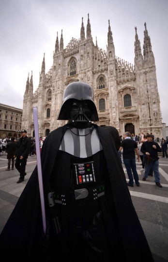 "A cosplayer dressed as Darth Vader of ""Star Wars"" stands in front of Milan's Duomo on May 3, 2015 as part of Star Wars Day. (AFP Photo/Filippo Monteforte)"