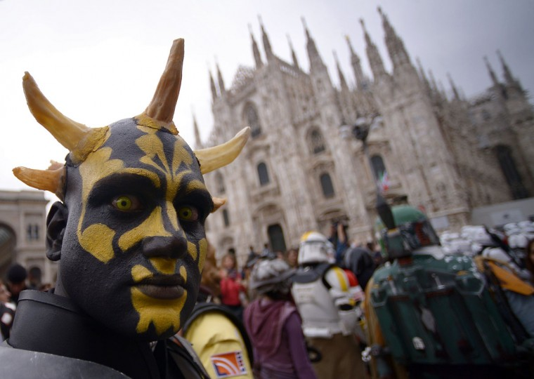 "A cosplayer dressed as Darth Maul of ""Star Wars"" stands in front of Milan's Duomo on May 3, 2015 as part of Star Wars Day. (AFP Photo/Filippo Monteforte)"