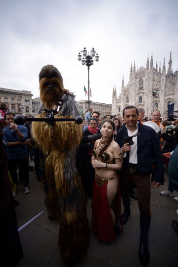 "Cosplayers dressed as ""Star Wars"" characters Chewbacca, Princess Leia and Han Solo pose near Milan's Duomo on May 3, 2015 as part of Star Wars Day. (AFP Photo/Filippo Monteforte)"