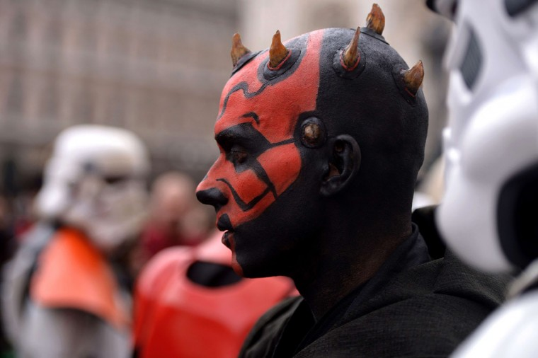 "A cosplayer dressed as ""Star Wars"" character Darth Maul attends a Star Wars Day event in Milan on May 3, 2015. (AFP Photo/Filippo Monteforte)"