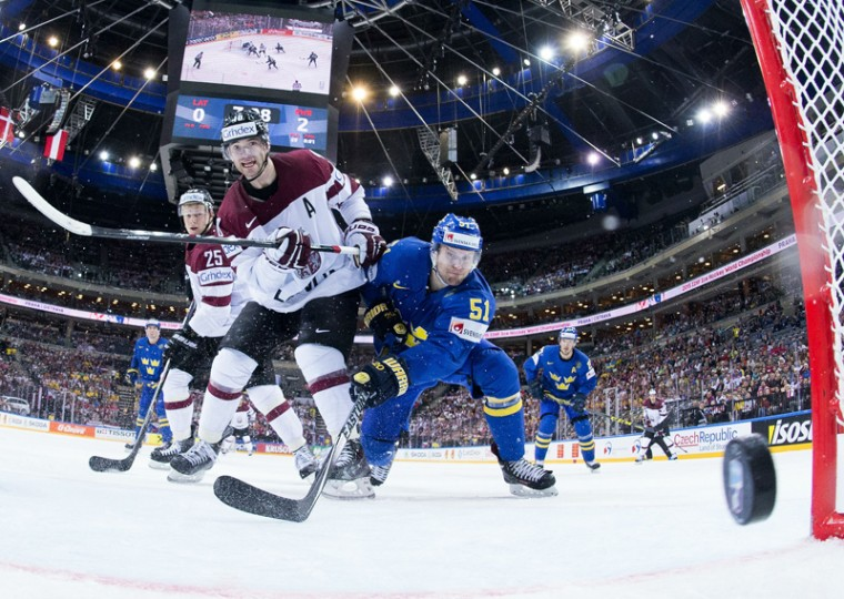 Forward Lauris Darzins of Latvia shoots during the group A preliminary round ice hockey match Latvia vs Sweden of the IIHF International Ice Hockey World Championship on Monday at the O2 Arena in Prague. (JOEL MARKLUND/AFP/Getty Images)
