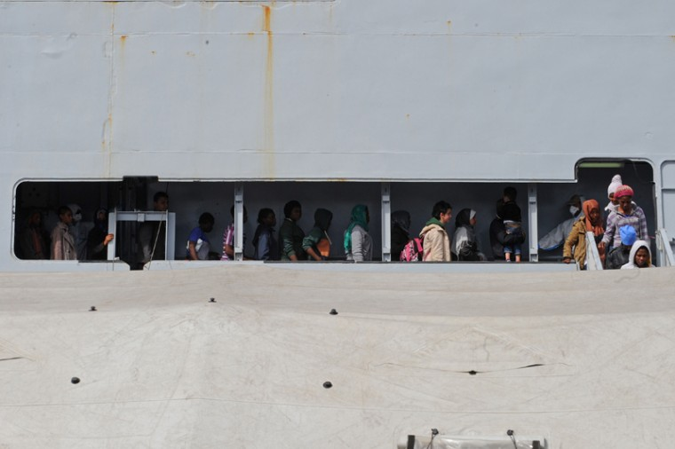 Women disembark from the military ship Bettica after a rescue operation of migrants at sea on Tuesday in the port of Salerno, southern Italy. Italy reacted Monday to the arrival of thousands of new migrants at its southern ports by demanding that its European Union partners meet the cost of taking them in. Speaking after the weekend rescue of nearly 6,000 migrants in the Mediterranean, Foreign Minister Paolo Gentiloni said promises made at last month's EU summit after a migrant boat disaster left 750 dead had to be honored. (MARIO LAPORTA/AFP/Getty Images)
