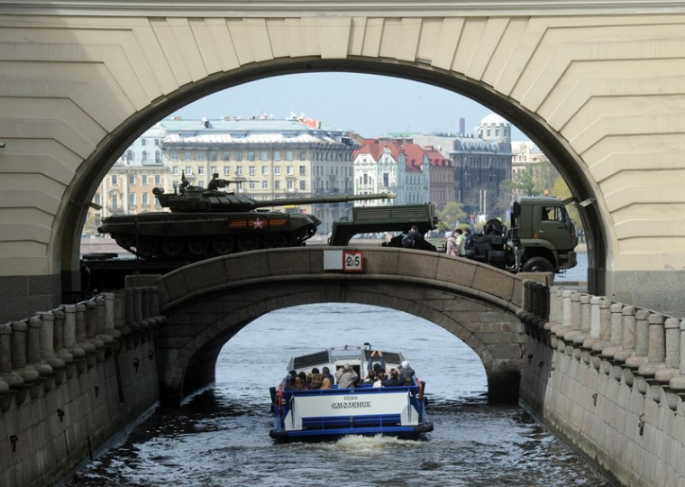 A truck with a T-72B3 tank rolls over a bridge in central Saint Petersburg, on Tuesday, during a rehearsal of the Victory Day parade. Russia will celebrate the 70th anniversary of the 1945 defeat of Nazi Germany on Saturday. (OLGA MALTSEVA/AFP/Getty Images)
