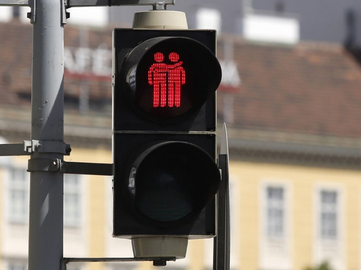A new traffic light, showing a same-sex couple, is pictured on Tuesday in Vienna. On the occasion of the upcoming Life Ball, the Eurovision Song Contest and the Rainbow Parade in Vienna, the Austrian capital seeks to promote tolerance and raise awareness to better road safety. (DIETER NAGL/AFP/Getty Images)