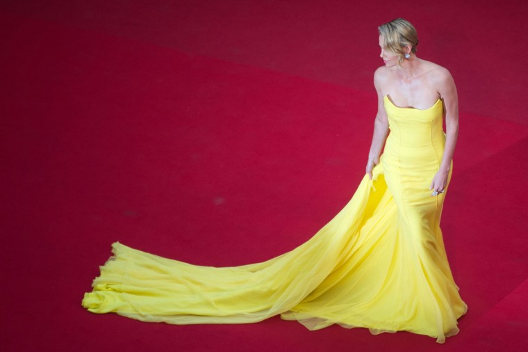 """Charlize Theron poses as she arrives for the screening of the film """"Mad Max : Fury Road"""" during the 68th Cannes Film Festival in Cannes, southeastern France, on May 14, 2015. (BERTRAND LANGLOIS/AFP/Getty Images)"""