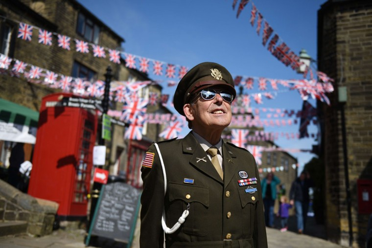 A man dressed up in the costume of a member of the US military from World War II smiles during the Haworth 1940s Weekend in the village of Haworth, Northern England on May 15, 2015. Each year the village celebrates the 1940s with a program of events and a re-enactment of the period in the village. (OLI SCARFF/AFP/Getty Images)