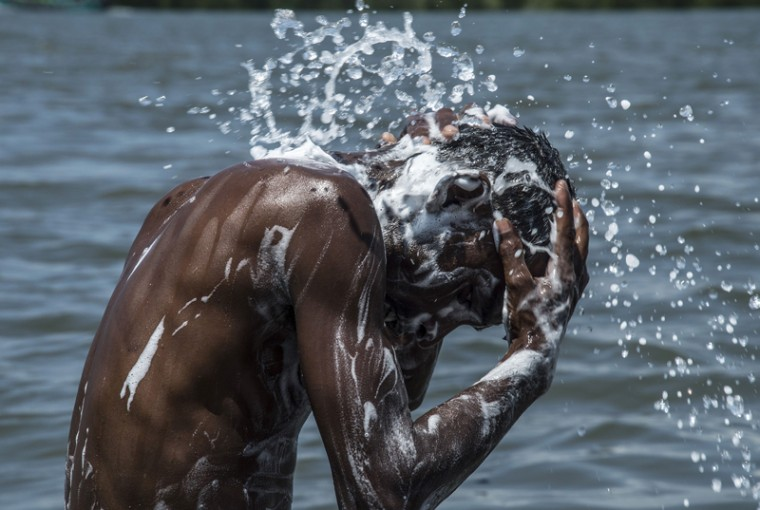 A rescued migrant from Bangladesh washes himself at a holding facility for rescued migrants in Langsa on Tuesday. Indonesia said that the migrant boat crisis was a problem for all of Southeast Asia, ahead of key regional talks, as Jakarta and other countries came under more pressure to let the boat people land. (SUTANTA ADITYA/AFP/Getty Images)