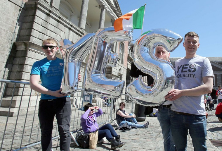 Supporters for same-sex marriage hold an inflatable Yes sign as they wait for the announcement on the referendum in Dublin castle on May 23, 2015. Ireland appeared to have voted to allow gay marriage today in a historic referendum which would see the historically Catholic country become the world's first to make the change after a popular vote. (Paul FaithAFP/Getty Images)