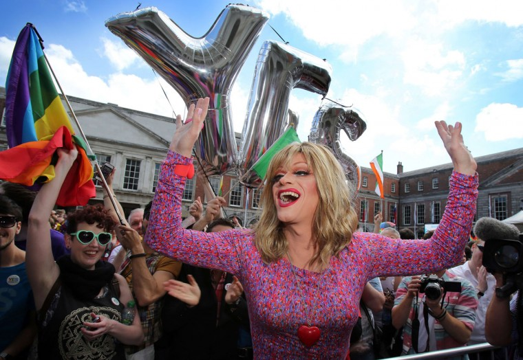 Drag queen and gay rights activist, Rory O'Neill, also known by his stage name Panti raises her arms by supporters for same-sex marriage at Dublin Castle as they wait for the result of the referendum on May 23, 2015. Yes voters were basking in the sunshine today as they gathered to celebrate an expected victory in Ireland's referendum on whether to approve same-sex marriage. (Paul Faith/AFP/Getty Images)
