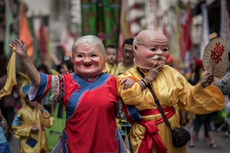 Performers wearing traditional costumes and masks march during a parade celebrating the birthday of the sea deity Tam Kung in Hong Kong, on Monday. According to the legend, Tam Kung, also known as Lord Tam the sea god, had the powers to contain winds and storms, making him a popular among fishermen to become a patron deity of the seafarers. (PHILIPPE LOPEZ/AFP/Getty Images)