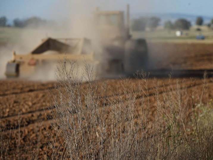 A farmer ploughs his dusty field in Sheldon as a severe drought continues to affect California on May 25, 2015. California has recently announced sweeping statewide water restrictions for the first time in history in order to combat the region's devastating drought, the worst since records began. (Mark Ralston/AFP/Getty Images)