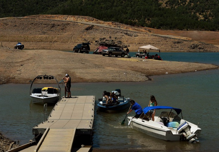 People launch their boats near an almost dry section of the Shasta Lake reservoir which is now at less than 20 percent capacity as a severe drought continues to affect California on May 25, 2015. California has recently announced sweeping statewide water restrictions for the first time in history in order to combat the region's devastating drought, the worst since records began. (Mark Ralston/AFP/Getty Images)