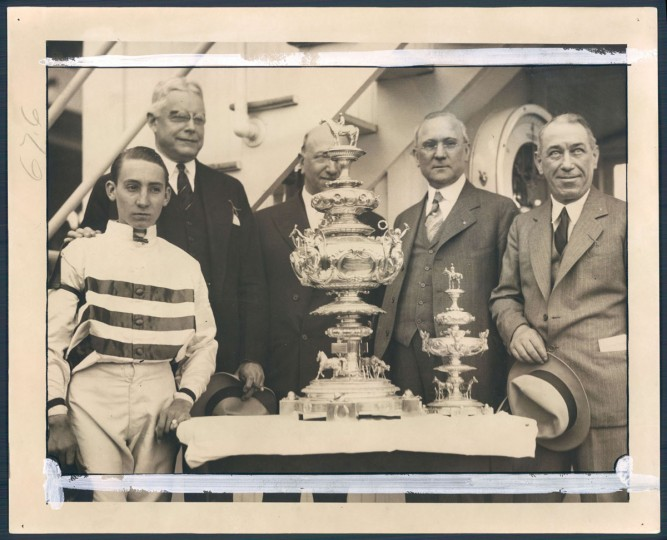 Eugene James piloted Burgoo King to victory, while Governor Albert Ritchie, Mr. Henry Horn, Democratic nominee for Governor of Illinois, and Mr. H. J. Thompson, trainer of E.R. Bradley's winning horse, took part in the presentation of the Woodlawn Vase at the judges' stand after the 1932 Preakness. (Baltimore Sun archives)