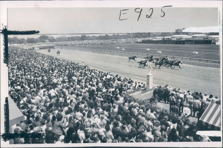 Field in first passes stands yesterday at Pimlico as large Preakness Day crowd watches. The turnout of 61,657 established record. (George Cook/Baltimore Sun, 1973)