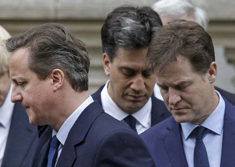 Britain's Prime Minister David Cameron,  left, Labour Party leader Ed Miliband, center, and Liberal Democrat Party Leader Nick Clegg, right, depart during the 70th anniversary VE Day service of remembrance at the Cenotaph on Whitehall in London, Friday, May 8, 2015, with Boris Johnson left. David Cameron's Conservative Party swept to power Friday in Britain's Parliamentary General Elections, winning an unexpected majority.  || CREDIT: TIM IRELAND - AP PHOTO