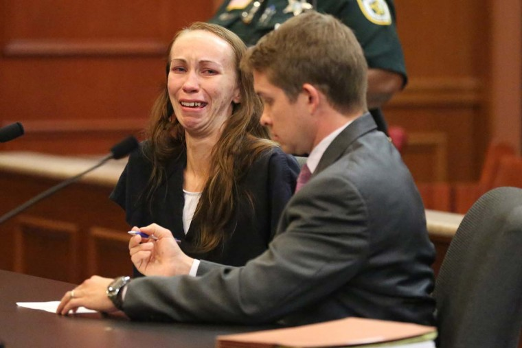 Heather Hironimus, sitting with her attorney Thomas Hunker, breaks down as she signs consent for her 4-year-old son to be circumcised, during a hearing, Friday, May 22, 2015, in Delray Beach, Fla. Hironimus' yearslong battle against her child's father over the boy's circumcision ended Friday, with her agreeing to the procedure in exchange for her release from jail. (Amy Beth Bennett/South Florida Sun-Sentinel via AP)