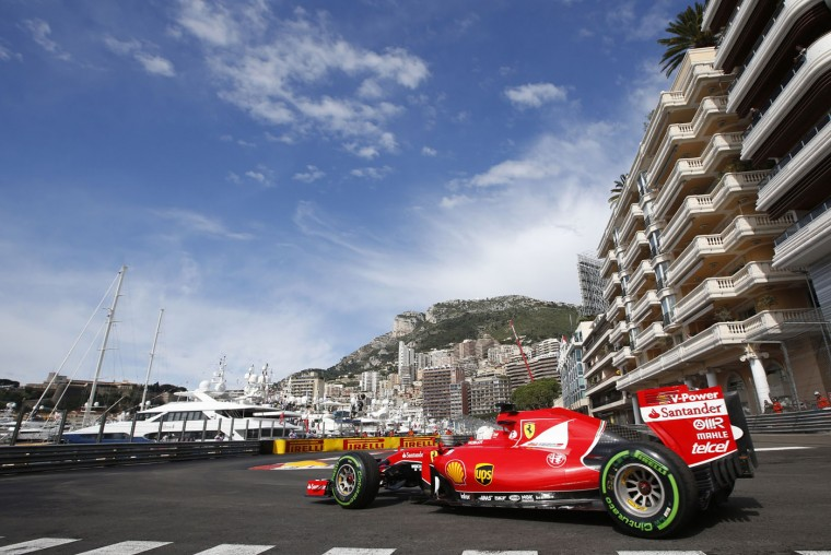 Ferrari driver Sebastian Vettel of Germany steers his car during the first free practice at the Monaco racetrack, in Monaco, Thursday, May 21 2015. The Formula one race will be held on Sunday. (AP Photo/Luca Bruno)