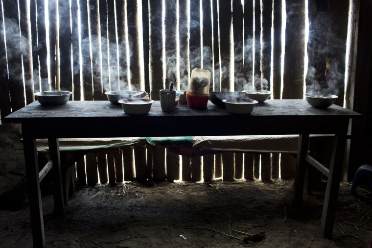 This March 15, 2015 photo shows steaming bowls of chicken soup on a table set for a special meal marking the second death anniversary of cocaine backpacker Yuri Galvez, in La Mar, province of Ayacucho, Peru. Galvez, 25, was found dead two years earlier after a smuggling trip with other backpackers. (AP Photo/Rodrigo Abd)