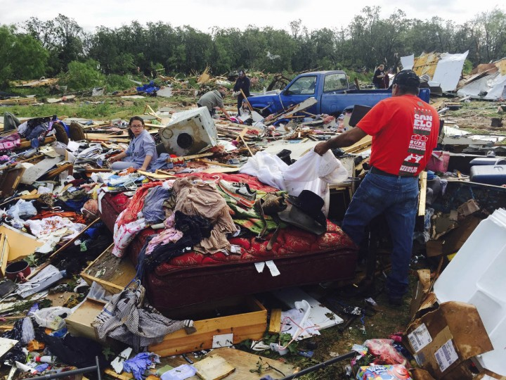 Residents sift through their belongings, Wednesday, May 20, 2015, after a tornado, the night before, destroyed homes near Balsora, Texas about 45 miles northwest of Fort Worth. A lingering storm system in North Texas has spawned at least two tornadoes, damaged buildings and flooded roads. The National Weather Service issued a flash flood watch Wednesday for the Dallas and Fort Worth areas. (Joyce Marshall/The Fort Worth Star-Telegram via AP)