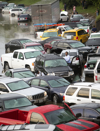 Motorists are stranded Tuesday along I-45 along North Main in Houston after storms flooded the area. Overnight heavy rains caused flooding, closing some portions of major highways in the Houston area. (Cody Duty/Houston Chronicle via AP)