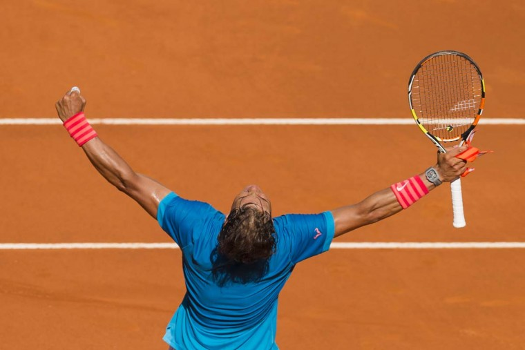 Rafel Nadal from Spain celebrates after winning his Madrid Open tennis tournament match against Grigor Dimitrov from Bulgaria,  in Madrid, Spain, Friday, May 8, 2015.  || CREDIT: DANIEL OCHOA DE OLZA - AP PHOTO