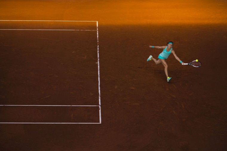 Lucie Safarova from Czech Republic returns the ball during her Madrid Open tennis tournament match against Svetlana Kuznetsova from Russia in Madrid, Spain, Thursday, May 7, 2015. (AP Photo/Daniel Ochoa de Olza)