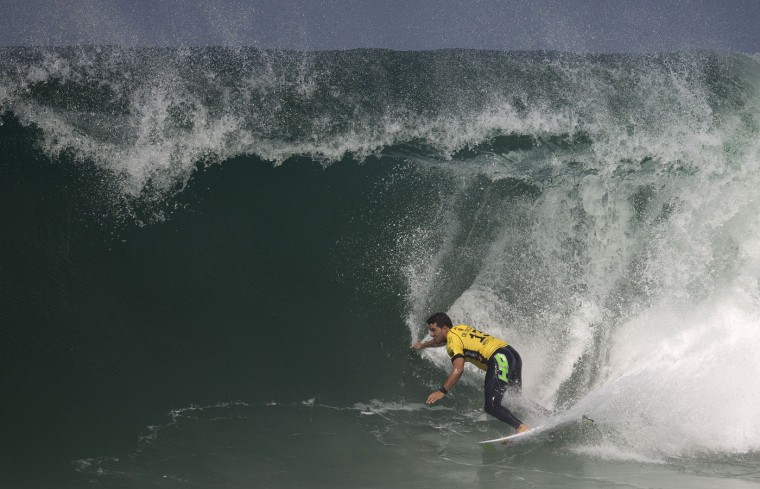 Brazil's Adriano de Souza competes in the 2015 Oi Rio Pro World Surf League competition at Barra da Tijuca beach in Rio de Janeiro, Brazil, Tuesday, May 12, 2015. (AP Photo/Leo Correa)