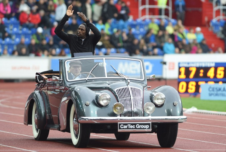 Jamaican sprinter Usain Bolt in a historical car greets spectators during the opening ceremony of the Golden Spike athletic meeting in Ostrava, Czech Republic, on Tuesday. (Jaroslav Ozana/CTK via AP)