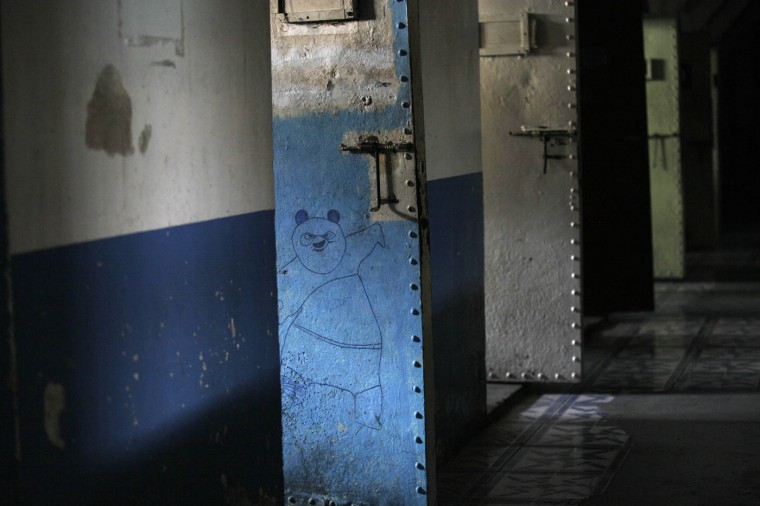 This April 7, 2015 photo shows a drawing of Po, the character from the Kung Fu Panda animated film, drawn on the door of a cell inside the now empty Garcia Moreno Prison, during a guided tour for the public in Quito, Ecuador. Now that this former world has been moved to another place, the time will soon come to erase the stories engraved on these walls. (AP Photo/Dolores Ochoa)