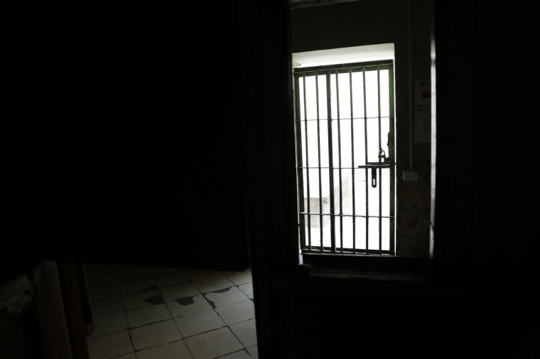 This April 9, 2015 photo shows a gate inside a wing at the now empty Garcia Moreno Prison, during a guided tour for the public in Quito, Ecuador. The buildingís fate remains undecided, but authorities say one project being looked at would convert the old prison in the heart of the city into a luxury hotel. Another proposal would convert it into a city museum. (AP Photo/Dolores Ochoa)