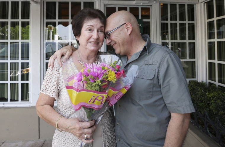 Arles Carballo, right, hugs his mother Esther Carballo on Mother's Day at a local restaurant Sunday, May 10, 2015, in Miami. (AP Photo/Alan Diaz)