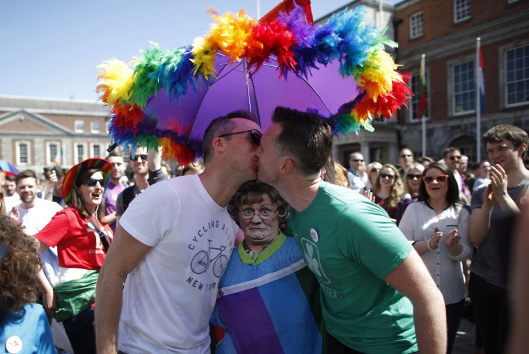 "Two men kiss as first results start to filter through in the referendum, Dublin, Ireland, Saturday, May 23, 2015. Ireland has voted resoundingly to legalize gay marriage in the world's first national vote on the issue, leaders on both sides of the Irish referendum declared Saturday even as official ballot counting continued. Senior figures from the ""no"" campaign, who sought to prevent Ireland's constitution from being amended to permit same-sex marriages, say the only question is how large the ""yes"" side's margin of victory will be from Friday's vote. (AP Photo/Peter Morrison)"