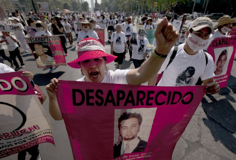 "Mothers, relatives and friends march with banners and posters showing images of relatives that have disappeared, during Mother's Day, in Mexico City, Sunday, May 10, 2015. The signs they hold reads in Spanish, ""Missing."" Mothers and other relatives of persons gone missing in the fight against drug cartels and organized crime are demanding that authorities locate their loved ones. (AP Photo/Marco Ugarte)"