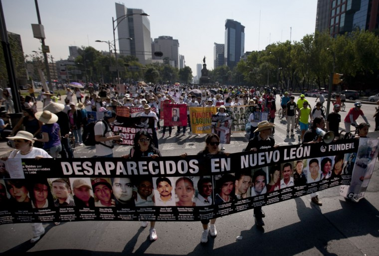 "Mothers, relatives and friends march with banners and posters showing images of relatives that have been disappeared, during Mother's Day in Mexico City, Sunday, May 10, 2015. The banner they hold reads in Spanish, ""The missing of Nuevo Leon."" Mothers and other relatives of persons gone missing in the fight against drug cartels and organized crime are demanding that authorities locate their loved ones. (AP Photo/Marco Ugarte)"