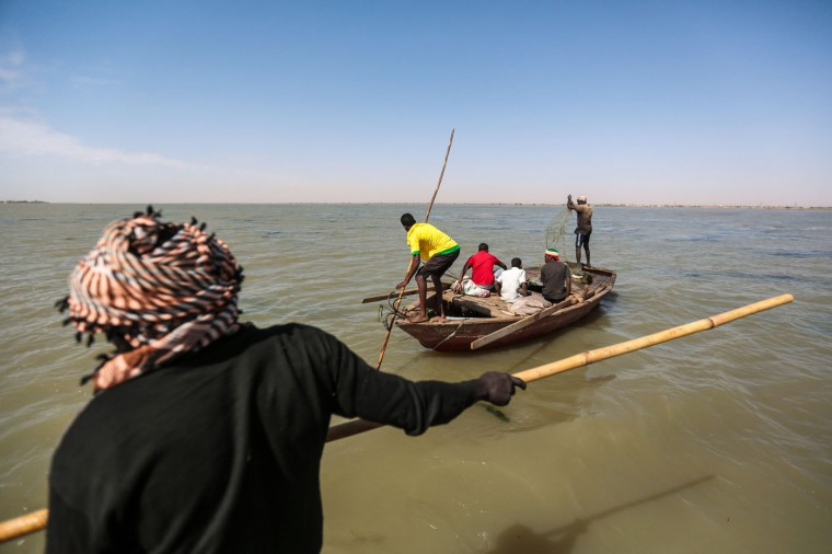 In this Wednesday, April 15, 2015 photo, Sudanese fishermen steer their boats while fishing in the Nile River on the outskirts of Khartoum, Sudan. (AP Photo/Mosa'ab Elshamy)