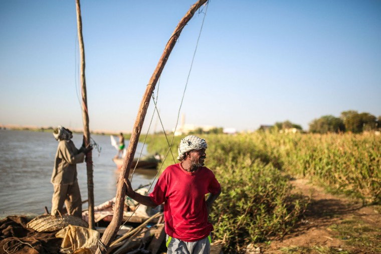 In this Wednesday, April 15, 2015 photo, Sudanese fishermen prepare their boats on the banks of the Nile River in the early morning hours, in Omdurman, Khartoum, Sudan. The worldís longest river, the Nileís water is shared by 11 countries, ending in Egypt and the Mediterranean Sea. Its main tributaries, the Blue and the White Niles, meet just north of Khartoum.(AP Photo/Mosa'ab Elshamy)