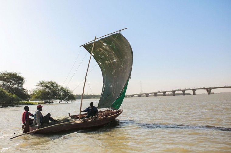 In this Wednesday, April 15, 2015 photo, Sudanese fishermen sail on the Nile River in the early morning hours, in Omdurman, Khartoum, Sudan. Nile fishermen sail for at least an hour towards an island off the coast of the capital, before throwing their nets into the water and waiting for the day's catch. (AP Photo/Mosa'ab Elshamy)