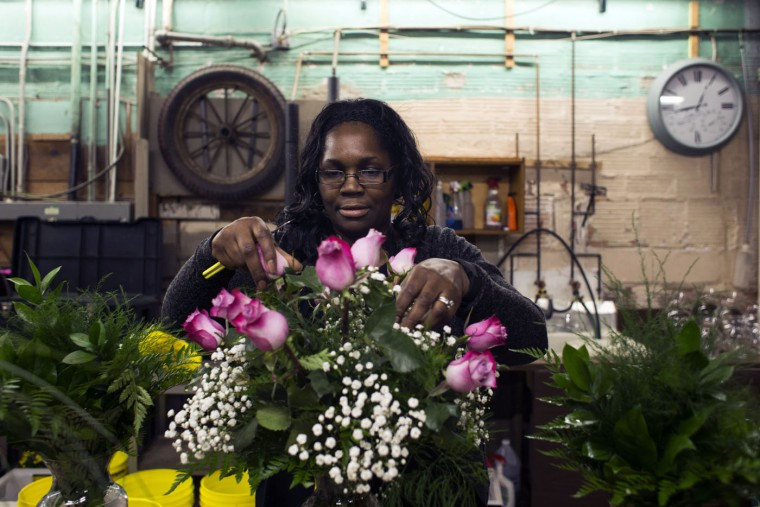 Design Manager Suzette Barbee, of Grand Blanc, prepares a floral arrangement for Mother's Day on Sunday, May 10, 2015, at Vogt's Flowers in Flint, Mich. (Brittany Greeson/The Flint Journal-MLive.com via AP)