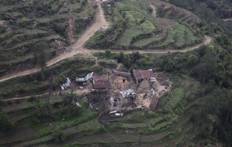 An aerial view of residential buildings damaged Saturday's earthquake at Trishuli Bazar in Nepal, Monday, April 27, 2015. The death toll from Nepal's earthquake is expected to rise depended largely on the condition of vulnerable mountain villages that rescue workers were still struggling to reach two days after the disaster. (AP Photo/Altaf Qadri)