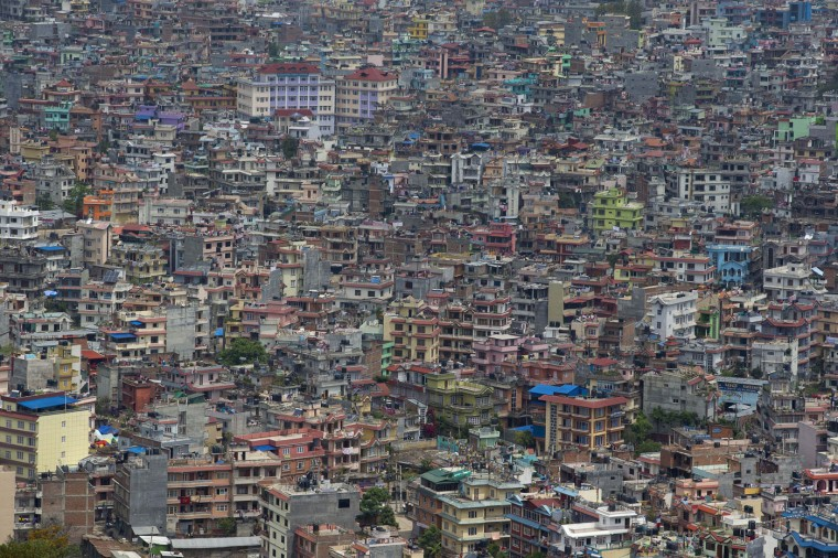 This April 29, 2015 file photo shows an aerial view of Kathmandu city as seen from a helicopter in Nepal. In mere seconds a powerful earthquake flattened a swathe of Nepal. Rebuilding the impoverished Himalayan nationís fragile economy will require a long slog, financed by foreign aid and money from its army of overseas workers. (AP Photo/Manish Swarup, File)
