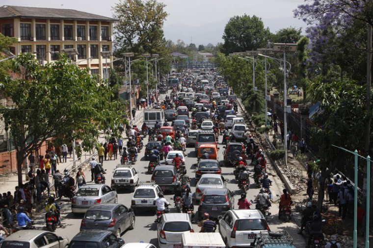 Traffic grinds to a halt after an earthquake hit Nepal in Kathmandu, Nepal, on Tuesday. A major earthquake hit a remote mountainous region of Nepal on Tuesday, triggering landslides and toppling buildings less than three weeks after the country was ravaged by another deadly quake. (Bikram Rai/AP)