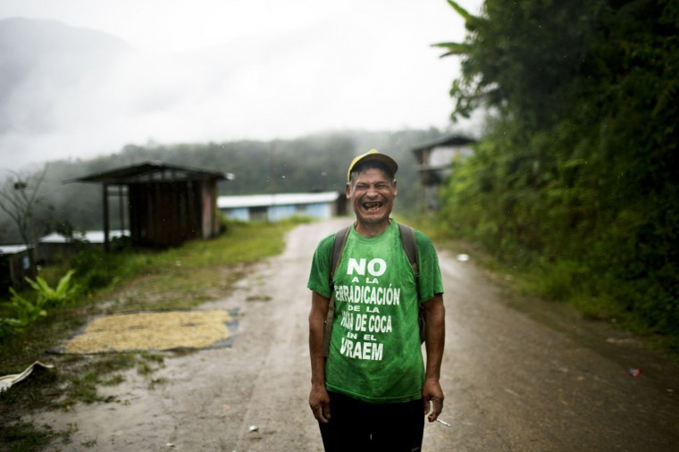 """In this March 15, 2015 photo, Fortunato Farfan laughs while posing for a photo in La Mar, province of Ayacucho, Peru. Fortunato is wearing a T-shirt with a phrase that reads in Spanish; """"No to coca eradication in the VRAEM."""" VRAEM is the acronym for Valley of the Apurimac, Ene and Mantaro rivers, where sixty percent of Peruís cocaine originates. (AP Photo/Rodrigo Abd)"""