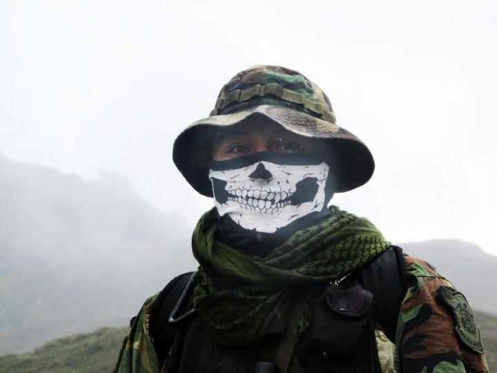 In this Feb. 28, 2015 photo, an elite policeman of the DIRANDRO counternarcotics police agency walks through a puna in Husnay, Peru, after an unsuccessful mission to try to arrest drug-toting backpackers hiking up from the worldís No. 1 cocaine-producing region. The backpackers can choose from myriad routes in a half dozen corridors of sparsely populated steppe. They often hike at night, to avoid detection. Few know before they are arrested that they face eight- to 15-year prison sentences. (AP Photo/Frank Bajak)