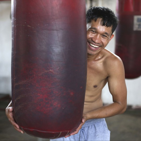 """In this April 21, 2015, photo, retired Filipino boxer and now trainer Rexon Flores poses inside a boxing gym in suburban Paranaque, south of Manila, Philippines. Flores, 33, said, ìThey all want to be champions ... but the most important thing is to not be swell-headed. If you become swell-headed, your boxing skills will suffer. You will just fool around and you will lose focus on boxing. """"Discipline is primary. If you don't have discipline, all your dreams will just flow away like water."""" (AP Photo/Aaron Favila)In this April 21, 2015, photo, retired Filipino boxer and now trainer Rexon Flores poses inside a boxing gym in suburban Paranaque, south of Manila, Philippines. Flores, 33, said, ìThey all want to be champions ... but the most important thing is to not be swell-headed. If you become swell-headed, your boxing skills will suffer. You will just fool around and you will lose focus on boxing. """"Discipline is primary. If you don't have discipline, all your dreams will just flow away like water."""" (AP Photo/Aaron Favila)"""