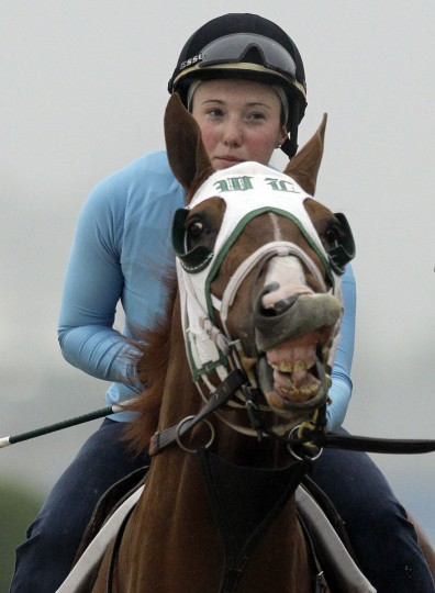 Exercise rider Arielle Witkowski takes Dublin for a workout in preparation for the 135th running of the Preakness horse race at Pimlico Race Course, Wednesday, May 12, 2010, in Baltimore. (AP Photo/Rob Carr)