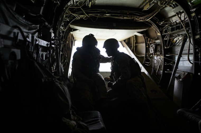 United States military forces talk during a flight during a joint military exercise with NATO Allies from Romania and Bulgaria, in Babadag Training Area, in Babadag, south-eastern Romania, on Tuesday.  (Andreea Alexandru/Mediafax via AP)
