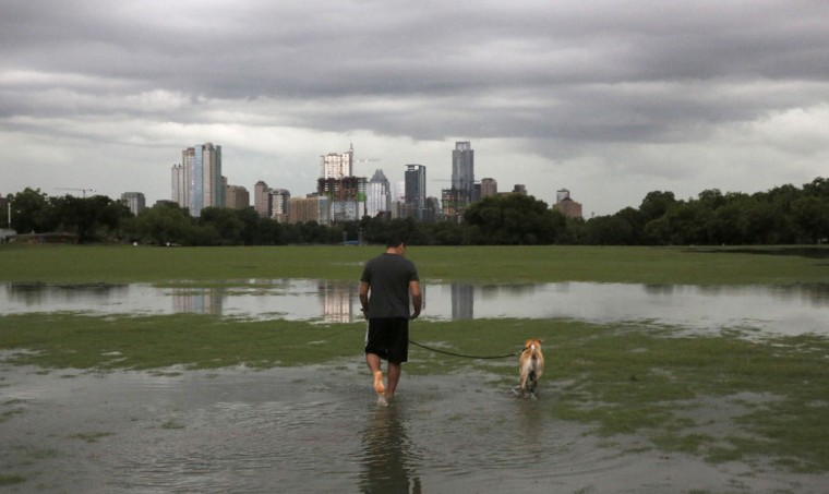 Flood waters spread across Zilker park near downtown Austin, Texas, Monday, May 25, 2015. Heavy rains and severe weather continued in the area causing widespread flooding. (James Gregg/Austin American-Statesman via AP)